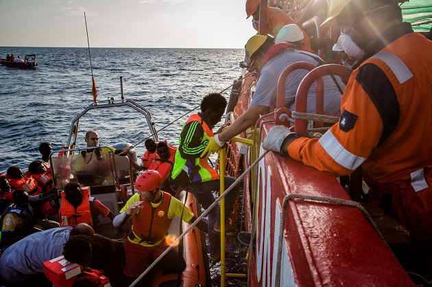 Refugees and migrants are brought on board the Vos Hestia after being rescued at sea. Picture courtesy of Save the Children.